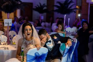 Bride and groom laughing at Best Man Speech